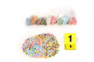 Seized pills of extasy contraband found by legal authorities during police search warrant