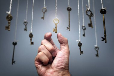Choosing the key to success from hanging keys concept