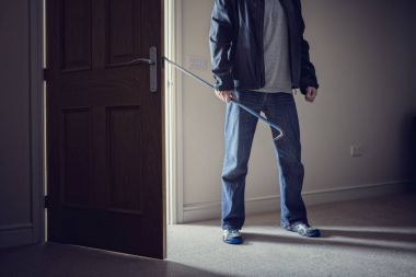 Burglar committing a burglary crime