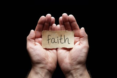 Faith message in cupped hands, concept for love, religion, belief and prayer