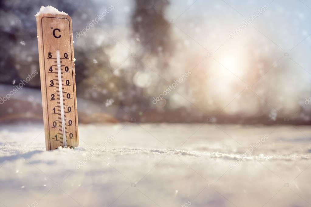 Thermometer in the snow with sub zero minus temperature concept for winter