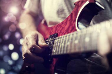 guitarist playing electric guitar