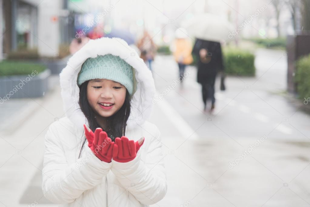 Girl in snow Asian