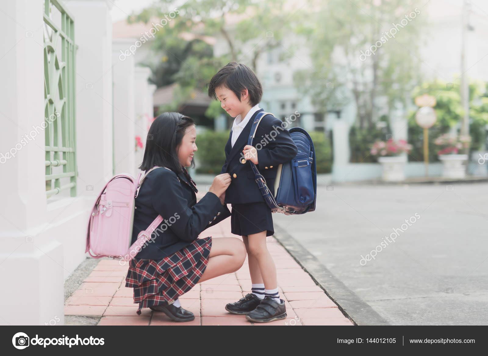 Asian schoolgirl with her uniform on mounts the du