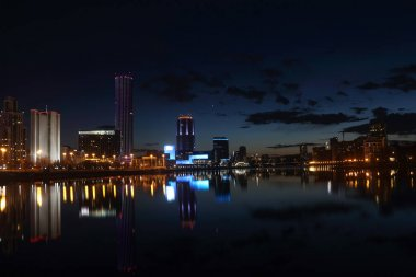 view on the night city by the river