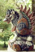 Fotografie colorful traditional Balinese God statue in Bali temple.