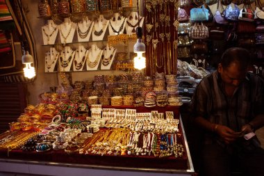indian man selling traditional jewelry