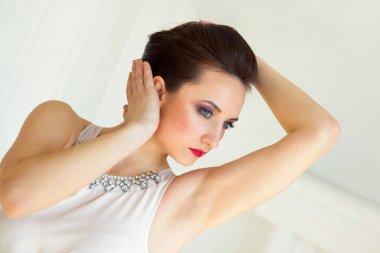 Girl fashion model in the studio