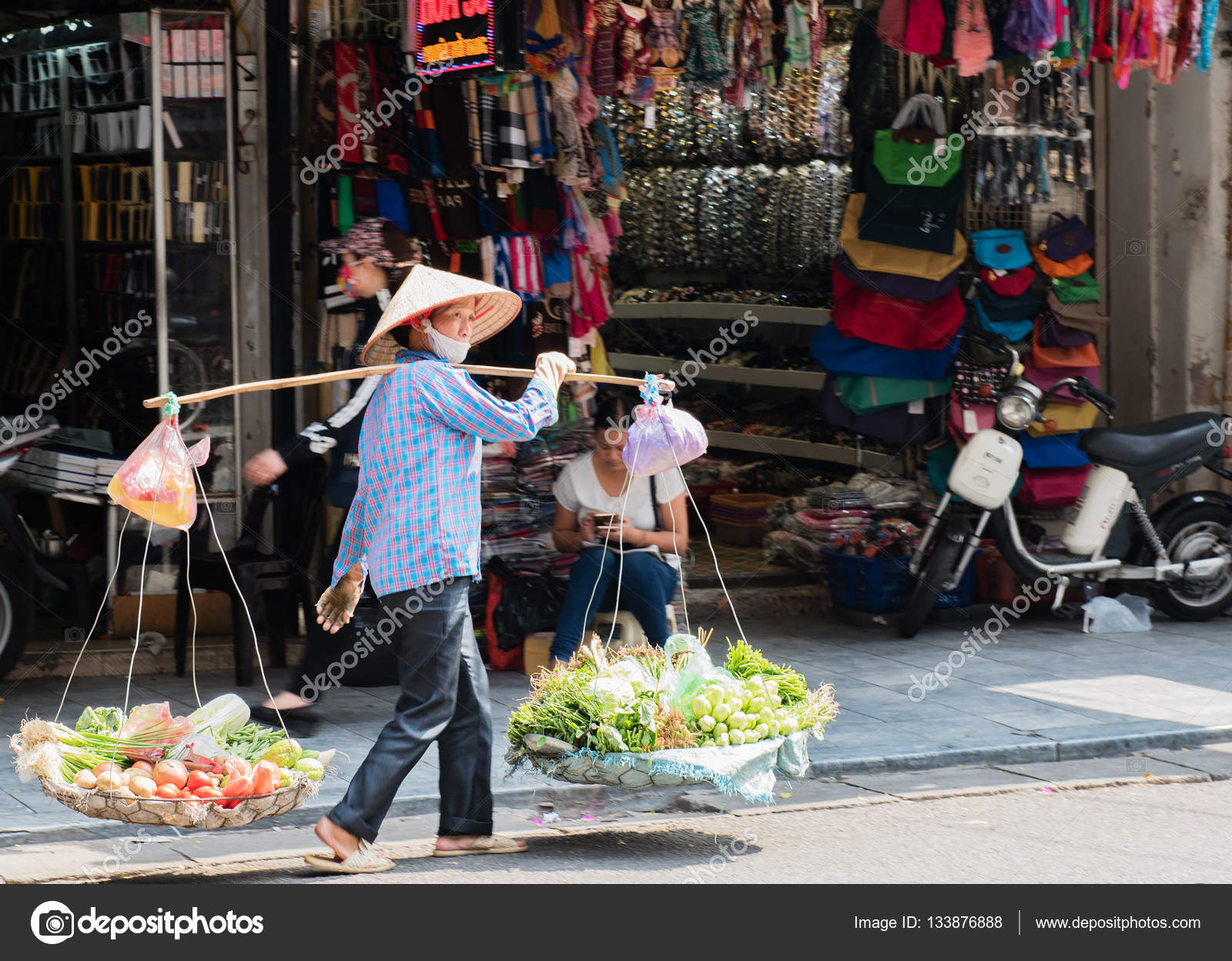 Vietnamese street vendors act and sell their vegetables and fruit ...