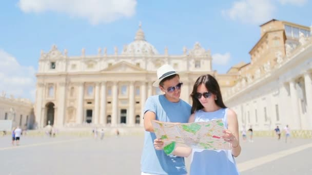 Happy couple tourists with map background St. Peters Basilica church in Vatican city, Rome, Italy.