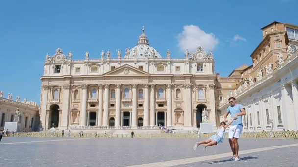Family having fun at St. Peters Basilica church in Vatican city, Rome. Happy travel father and little girl on european vacation in Italy.