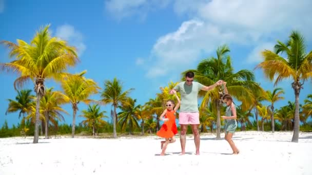 Happy family at tropical beach have fun. Father and little kids enjoy time together on white sand beach on their holiday
