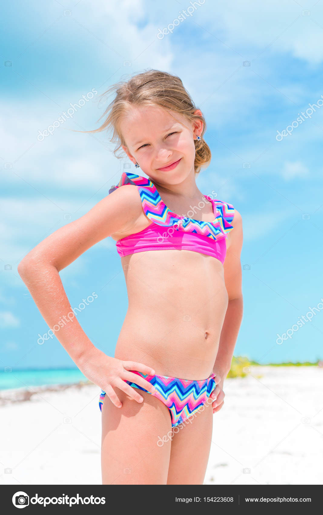 d5463e463538a Portrait of adorable little girl at beach during summer vacation ...