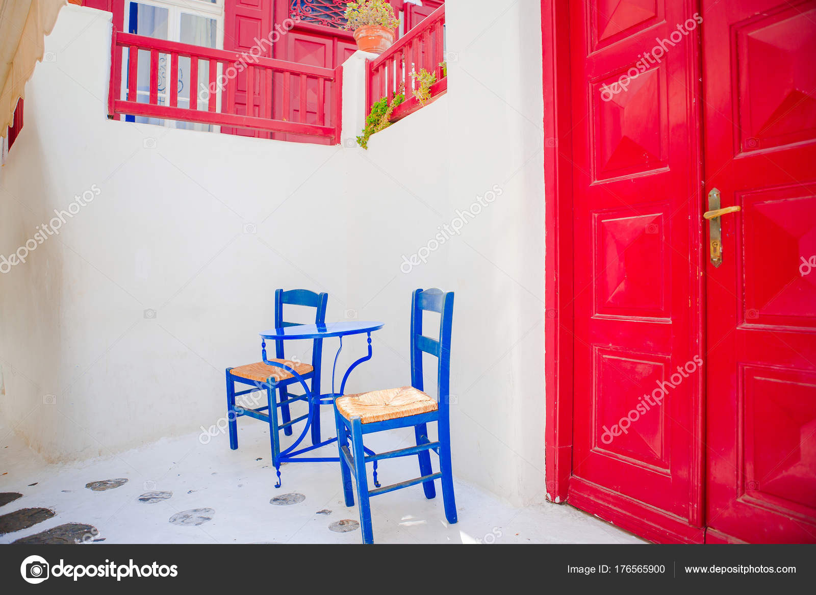 Admirable Outdoor Cafe With Blue Chairs On Street Of Typical Greek Short Links Chair Design For Home Short Linksinfo