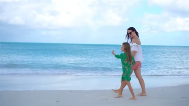 Beautiful mother and daughter on Caribbean beach.