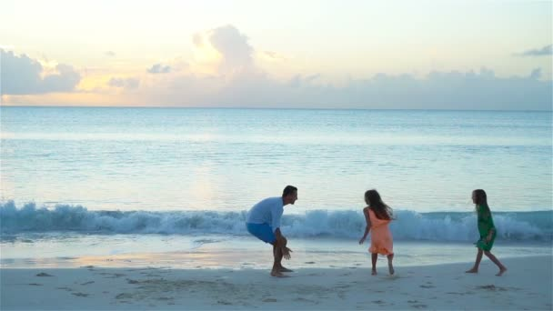 Family of father and little cute kids enjoying beach vacation. SLOW MOTION