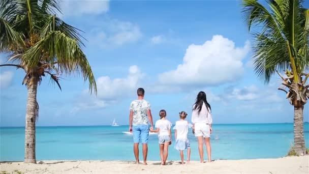 Family on the beach on caribbean vacation.