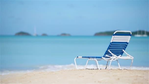 One chaise-longue on white tropical caribbean beach