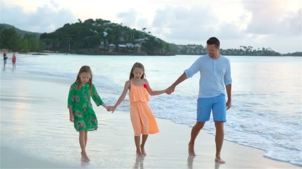 Father and kids enjoying beach summer tropical vacation. SLOW MOTION