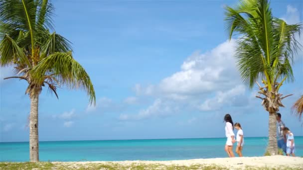 Beautiful mother and daughter on Caribbean beach. Family on beach vacation.