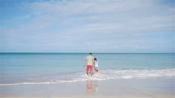 Family of father and little girl having fun on the beach