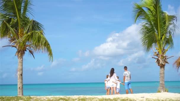 Family on the beach enjoy vacation