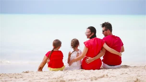 Young family having fun on white tropical caribbean beach