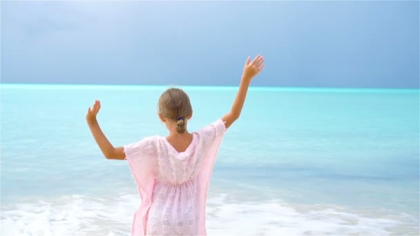 Adorable little girl on tropical beach