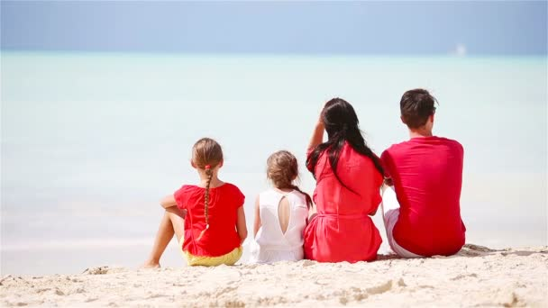 Family in red on the beach