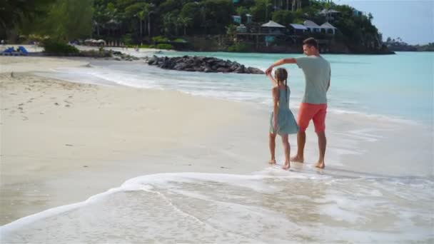 Family walking on the beach. Dad and kid together on the seashore
