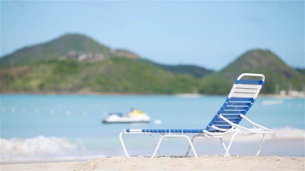 Sunbed on white tropical caribbean beach