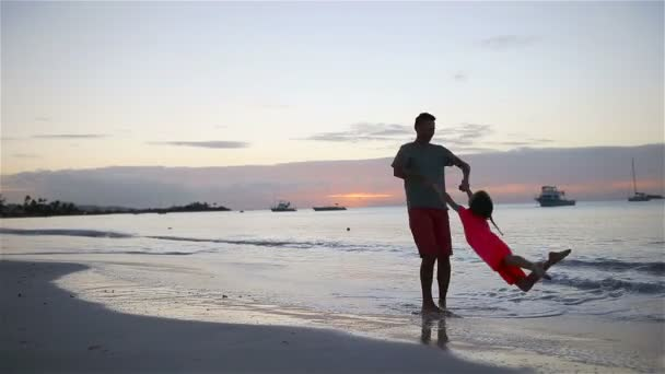 Family fun on white sand. Smiling father and adorable child playing at sandy beach