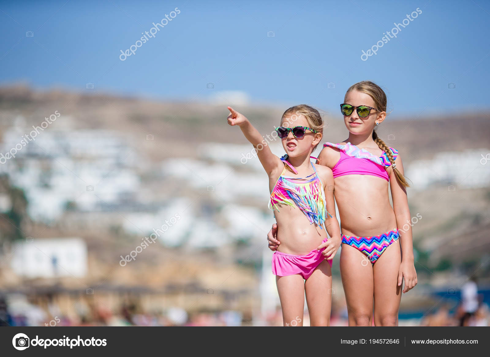 fd142efbd2df5 Adorable little girls having fun during beach vacation. Two kids together  on greek vacation — Photo by ...
