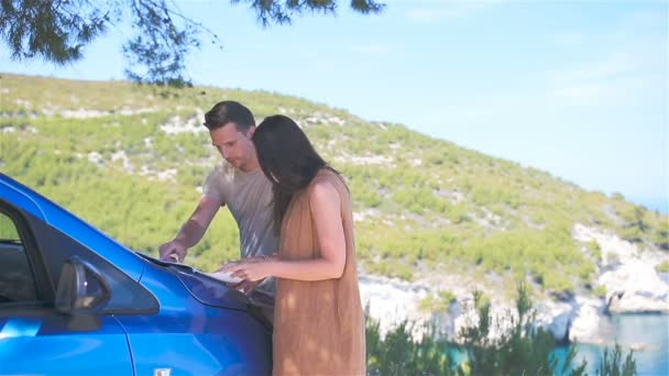 Young couple tourist with map travelling by car