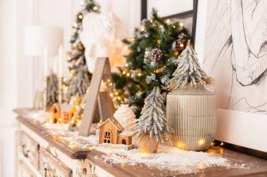 Nizhniy Novgorod, Russia - November 4, 2019: Photo studio 2.8. Lots of Christmas decorations standing on wooden desk. Selective focus