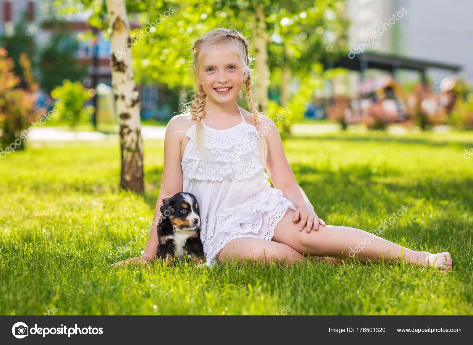 Little Blonde Girl Playing Cute Black Puppy Sitting Green Grass