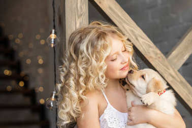 cute little girl hugging adorable puppy