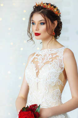 Gorgeous young woman in elegant wedding dress