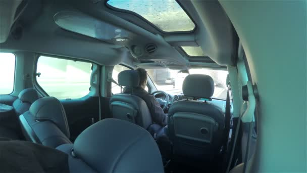 Rear view from inside car person driving