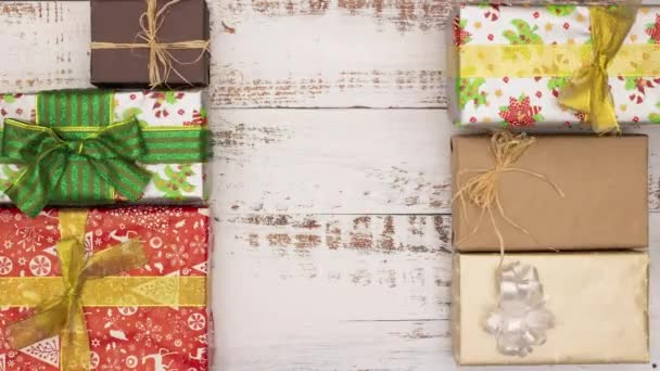 Christmas presents moving on wooden background - Stop motion