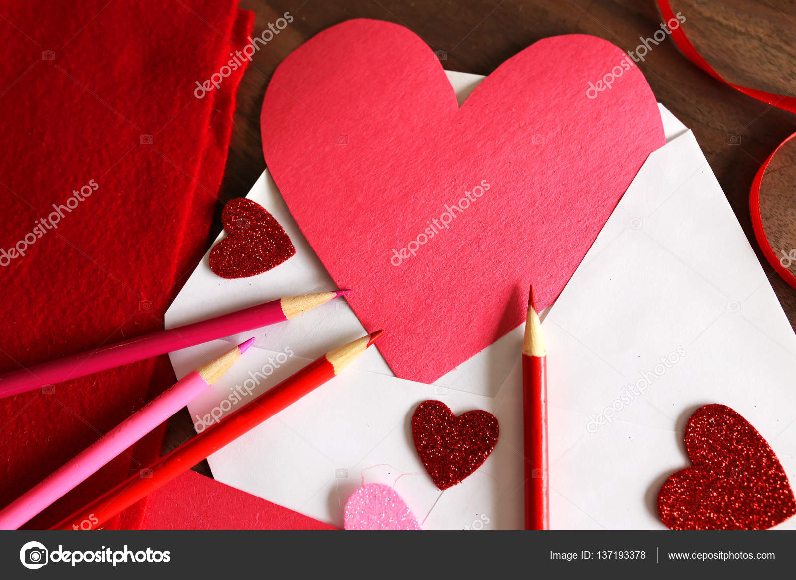 heart shaped valentine s day homemade card in envelope stock photo