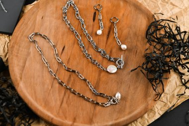 Silver jewelry for girls. View from above. Handwork. Layout of jewelry. flatlay. Gifts for women. Shopping for jewelry.