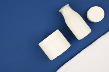 Body And Skin Hygienic Care Toiletry Products, In White Packaging On A Blue Background. Flat Lay