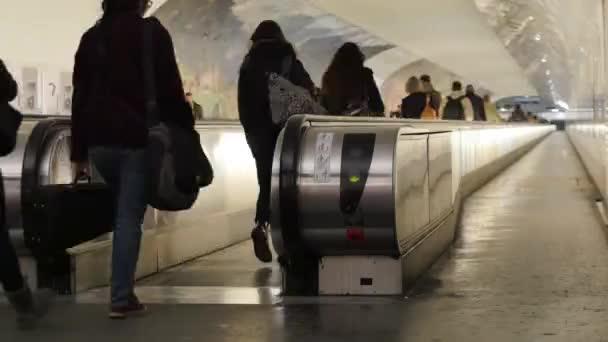 People on crossing Escalators
