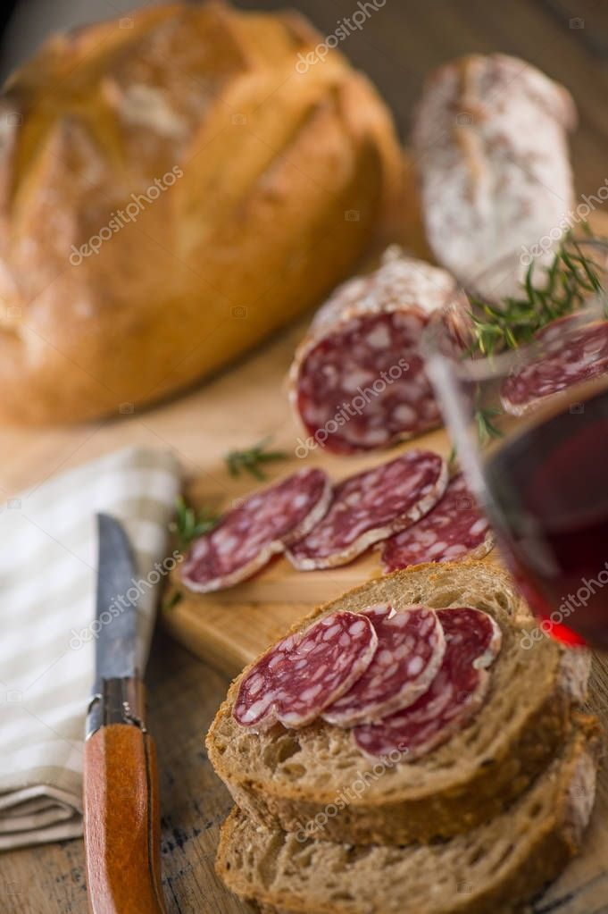 French salami Sausage on a wooden table