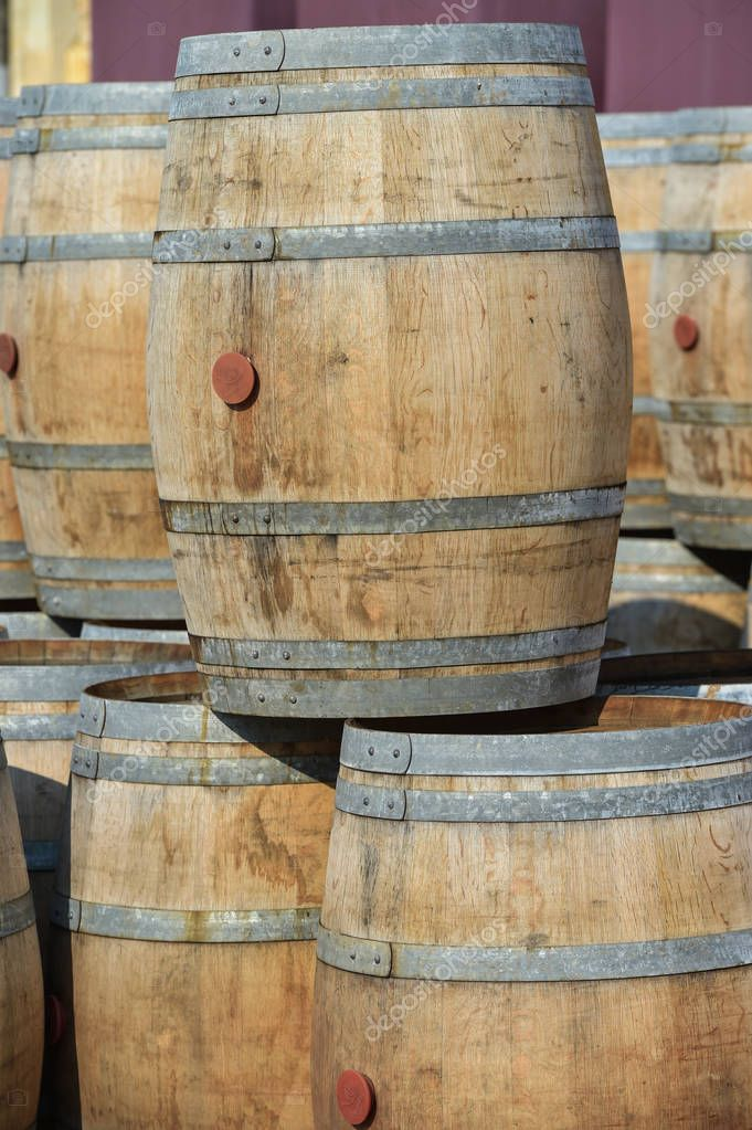 Storage of old barrels in a castle of Bordeaux vineyards, France