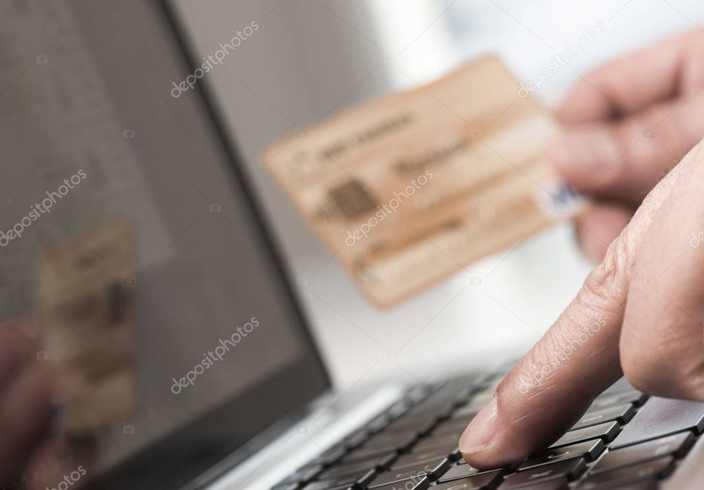 Man using tablet pc and credit card indoor, Shopping online