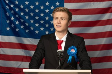 Confident emotional man on tribune on american flag background stock vector