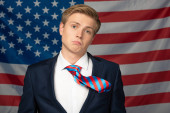Fotografie man grimacing on american flag background
