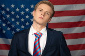 serious man on american flag background
